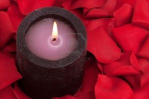 6470076-candle-surrounded-with-red-rose-petals