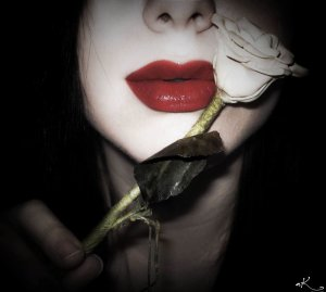 Lips_And_Rose_by_nicolizet